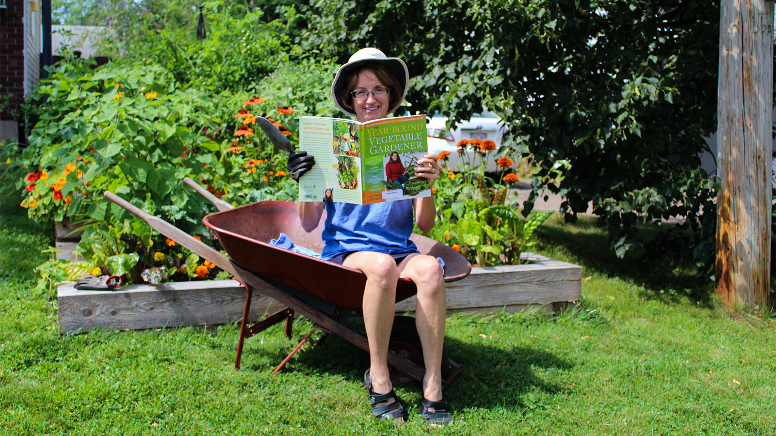 karen rogers in a wheelbarrow